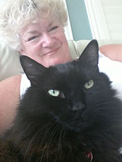 Fluffy black cat named Sammy pictured with his owner.